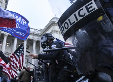 Members of the US police clashing with pro-Trump supporters on Wednesday.