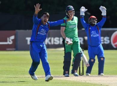 Rashid Khan (left) facing Ireland in 2018.
