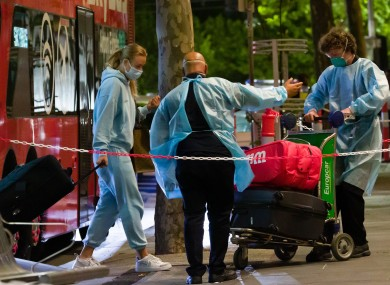 One of the first group of tennis players arriving at the Grand Hyatt hotel in Melbourne under strict quarantine conditions.