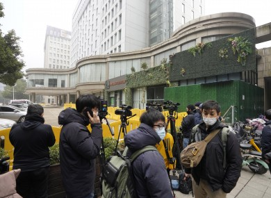 Journalists gather outside the hotel where a team of experts from the WHO were quarantined in Wuhan.