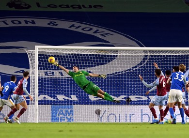 Emiliano Martinez in full flight.