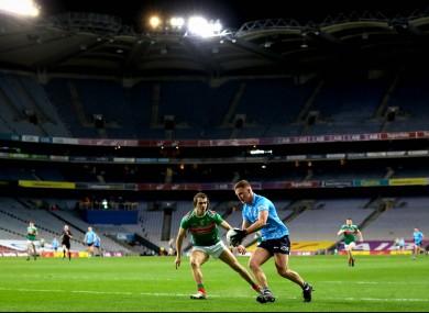 Dublin's Ciaran Kilkenny facing Oisín Mullin of Mayo in the 2020 All-Ireland senior football final.