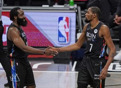 Kevin Durant congratulates Brooklyn Nets guard James Harden.