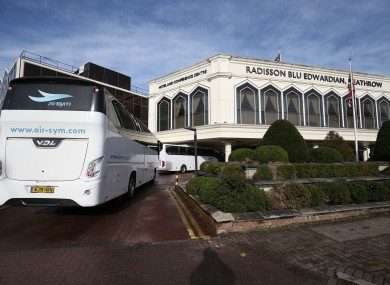 A coach carrying passengers arrives at the Radisson Blu Edwardian Hotel, near Heathrow Airport