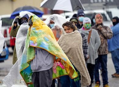 People wait in freezing rain in Houston, Texas