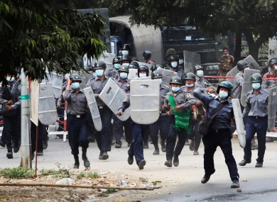 Police charge forward to disperse protesters in Mandalay, Myanmar