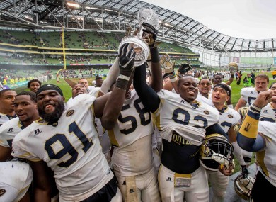 Georgia Tech players celebrate with the Keough-Naughton trophy after the 2016 fixture in Dublin.