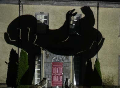 An image of a newborn baby is projected onto Sean Ross Abbey in Co Tipperary for the Herstory Light Show on St Brigid's Day.