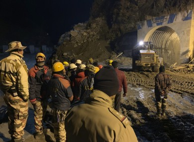 Police using heavy machinery to clear debris as they try to rescue more than three dozen power plant workers trapped in the tunnel