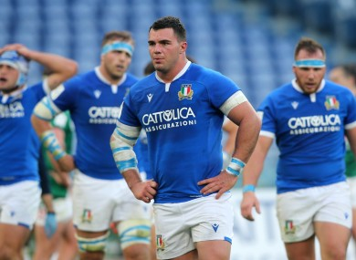 Italy players despondent after losing to Ireland.