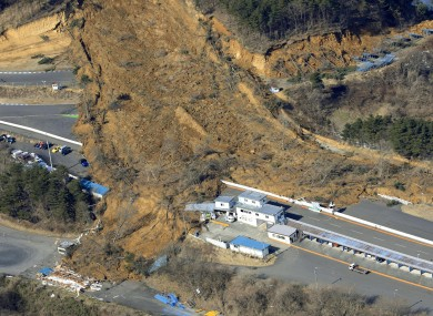A landslide caused by a strong earthquake covers a circuit course in Nihonmatsu city, Fukushima