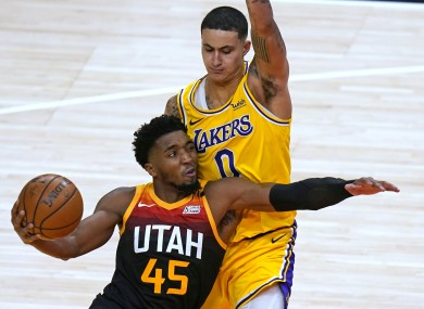 Utah Jazz guard Donovan Mitchell (45) drives against Los Angeles Lakers forward Kyle Kuzma.