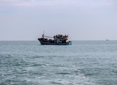 File photo - A wooden boat carrying dozens of Rohingya is seen visible as far as 1 kilometre from the coast in North Aceh Regency