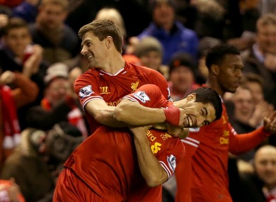 Liverpool's Steven Gerrard (left) celebrates with team-mate Luis Suarez.