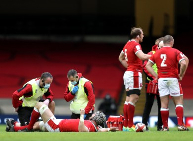 Dan Lydiate receives medical attention.
