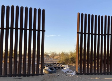 The hole cut into the US border fence in southern California
