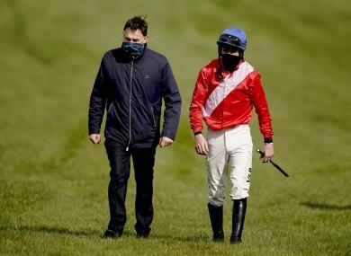 Jockey Jack Kennedy is met by trainer Henry de Bromhead after falling from Envoi Allen.