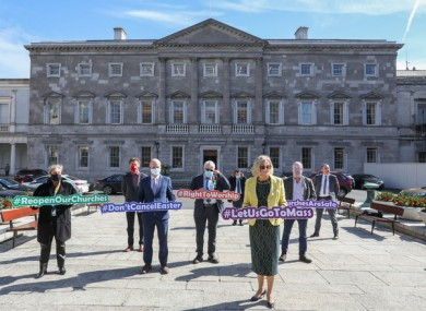 Oireachtas members gathered at Leinster House this morning calling for mass to be allowed to go ahead.