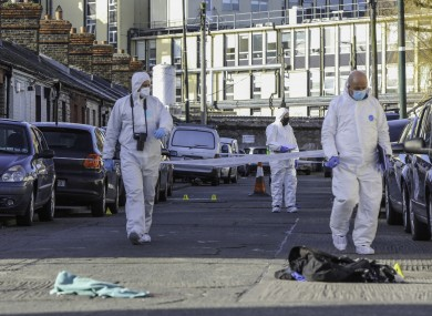 Garda technical bureau members at the scene of the shooting.