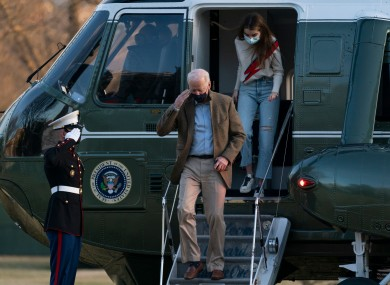 President Joe Biden, followed by his granddaughter Natalie Biden, disembarks Marine One on the South Lawn upon arrival at the White House