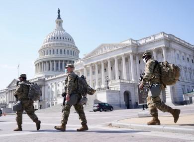 National Guard members walk near the Capitol