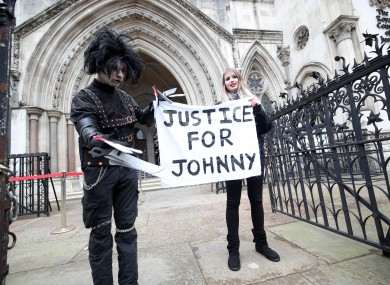 Supporters of Johnny Depp outside the Royal Courts of Justice in London today.