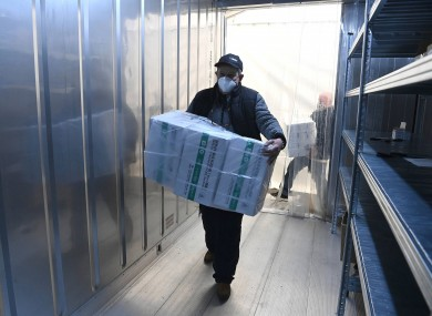 An employee unloads the newly arrived coronavirus vaccines in Budapest
