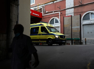 An ambulance leaves the emergency entrance of the Sao Jose Hospital in Lisbon