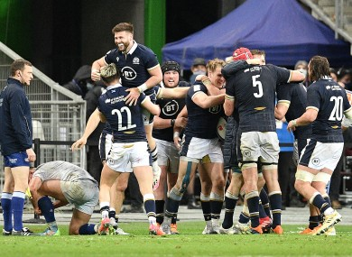 The Scotland players celebrate their win over France.