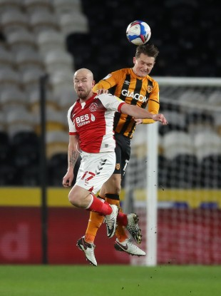 Hull City's Sean McLoughlin wins a header against Paddy Madden of Fleetwood Town.