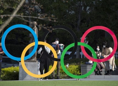 People taking pictures of the Olympic rings installed by the Japan Olympic Museum in Tokyo.