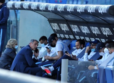 The Lazio players sit in the dugout last night.