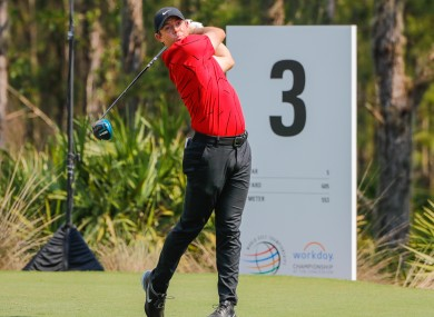 McIlroy was among the players to wear Woods' trademark red and black to pay tribute after the star's car crash.