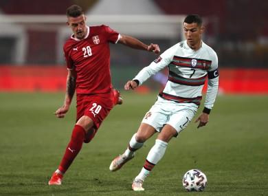 Cristiano Ronaldo in possession for Portugal while under pressure from Serbia's Sergej Milinkovic-Savic.