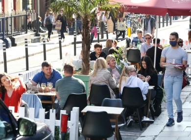 File image of people dining outdoors in Dublin last September.