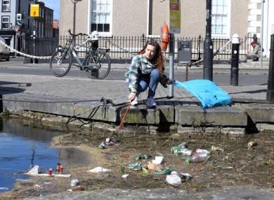 Local resident Juliana Hearty cleaning rubbish at Portobello in Dublin in April.