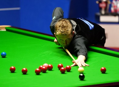 England's Kyren Wilson plays a shot during day 13 of the Betfred World Snooker Championships 2021 at The Crucible.