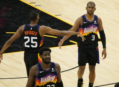 Phoenix Suns guard Chris Paul (3) is greeted by teammate forward Mikal Bridges (25) during the game.