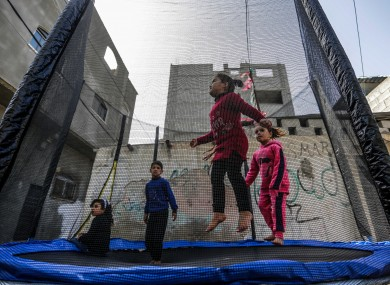 Palestinian children play on a street, in the Jabalia Palestinian refugee camp in the northern Gaza Strip