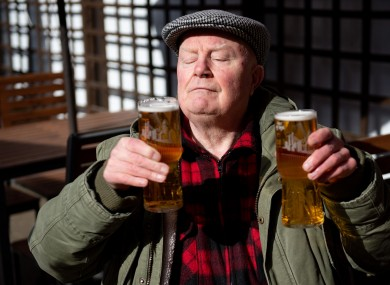John Witts enjoys a drink at the reopening of the Figure of Eight pub in Birmingham