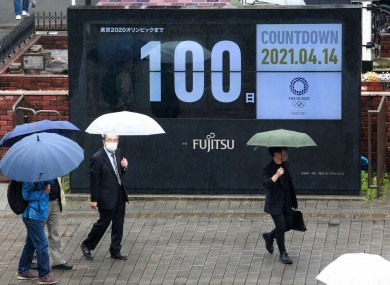 A countdown clock in Tokyo on Wednesday shows 100 days to go until the Games.