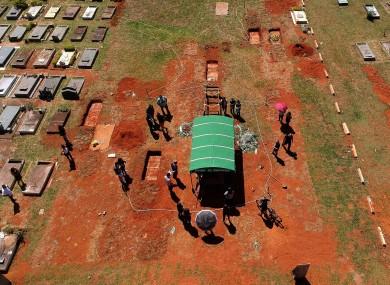 A family attending a burial service in Brasilia, Brazil.