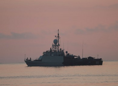 An Indonesian navy patrol ship sails to join the search for submarine KRI Nanggala