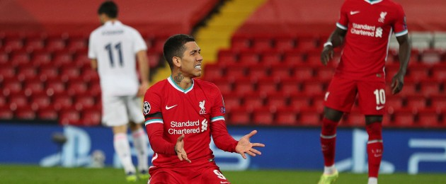 Liverpool's Roberto Firmino rues a missed chance.
