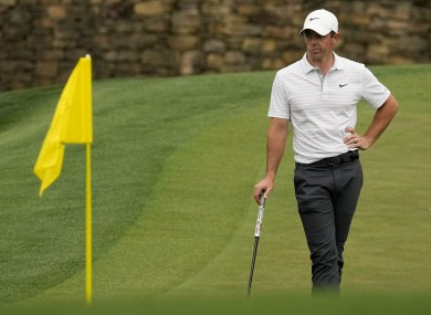 Rory McIlroy waits to putt on the 11th green.