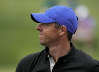 Rory McIlroy watches his tee shot.