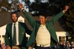 Hideki Matsuyama, of Japan, puts on the champion's green jacket after winning the Masters golf tournament.
