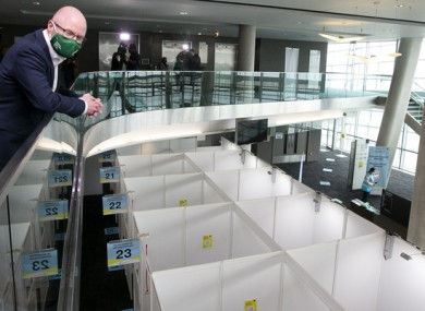 Health Minister Stephen Donnelly overlooks a vaccination centre.