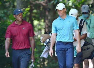 Woods and McIlroy on course at the Northern Trust tournament in Boston last year.