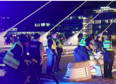 Gardaí at the scene of an attack on the Samuel Beckett Bridge last Monday.